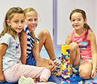 Friends building with LEGO® at SuperCamps