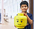 Child with LEGO® head at SuperCamps