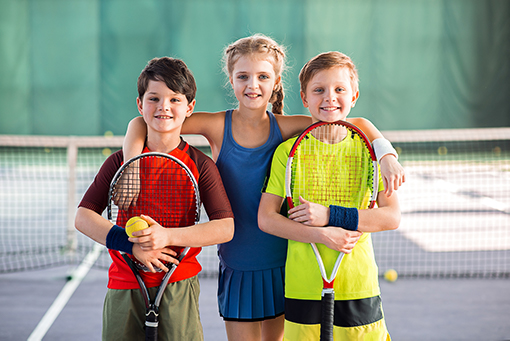 Girls-Boys-Playing-Tennis