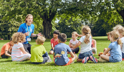 SuperCamps school holiday childcare at Russell House School, children playing circle games