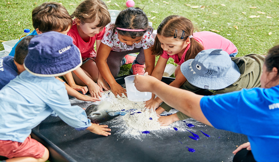 children taking part in messy play