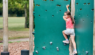 SuperCamps school holiday childcare at The Croft Preparatory School, outside play area trail with climbing wall