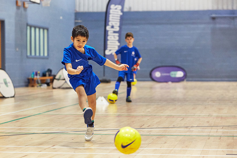 Boy playing football at Chelsea FC Foundation camp