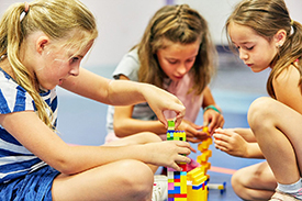 Children playing with LEGO at SuperCamps